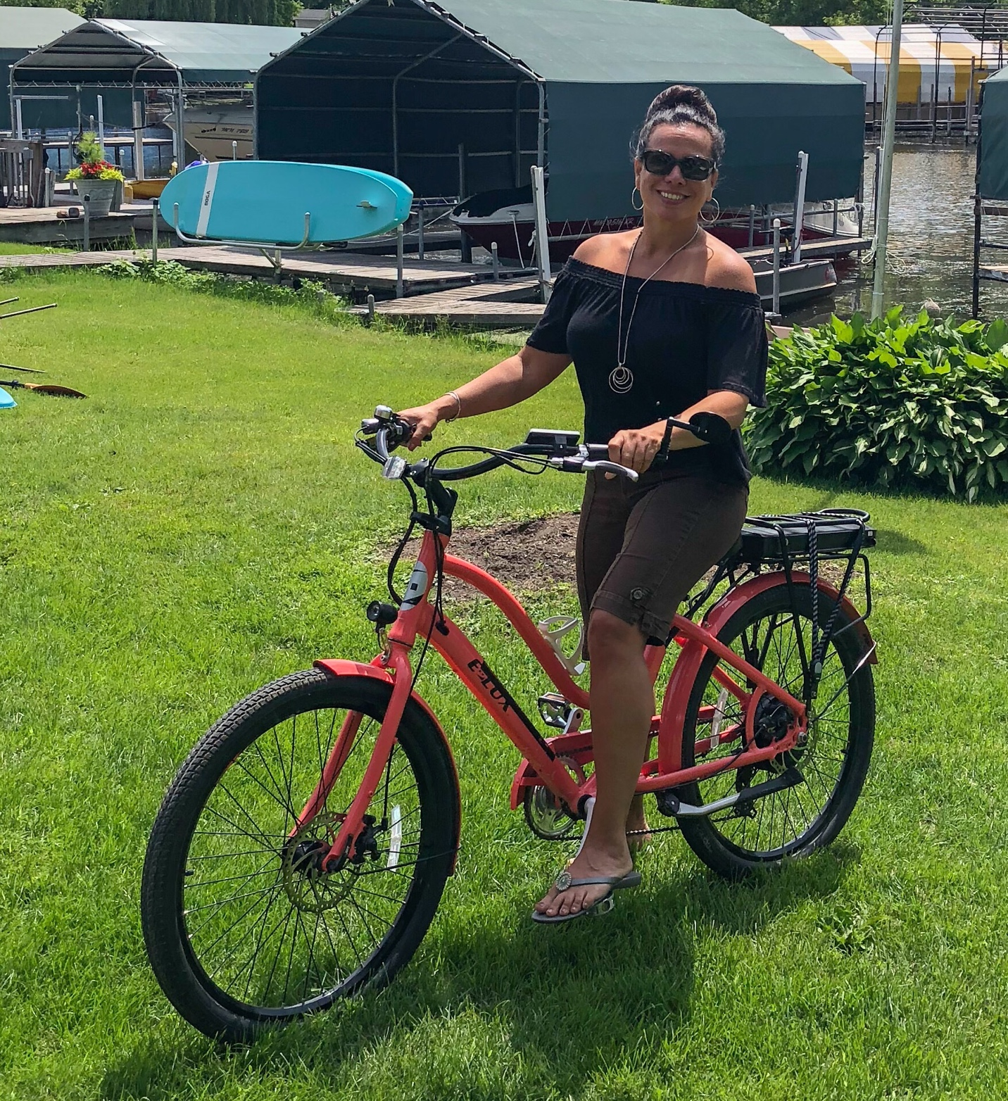 Woman riding bike and exploring Lake Minnetonka