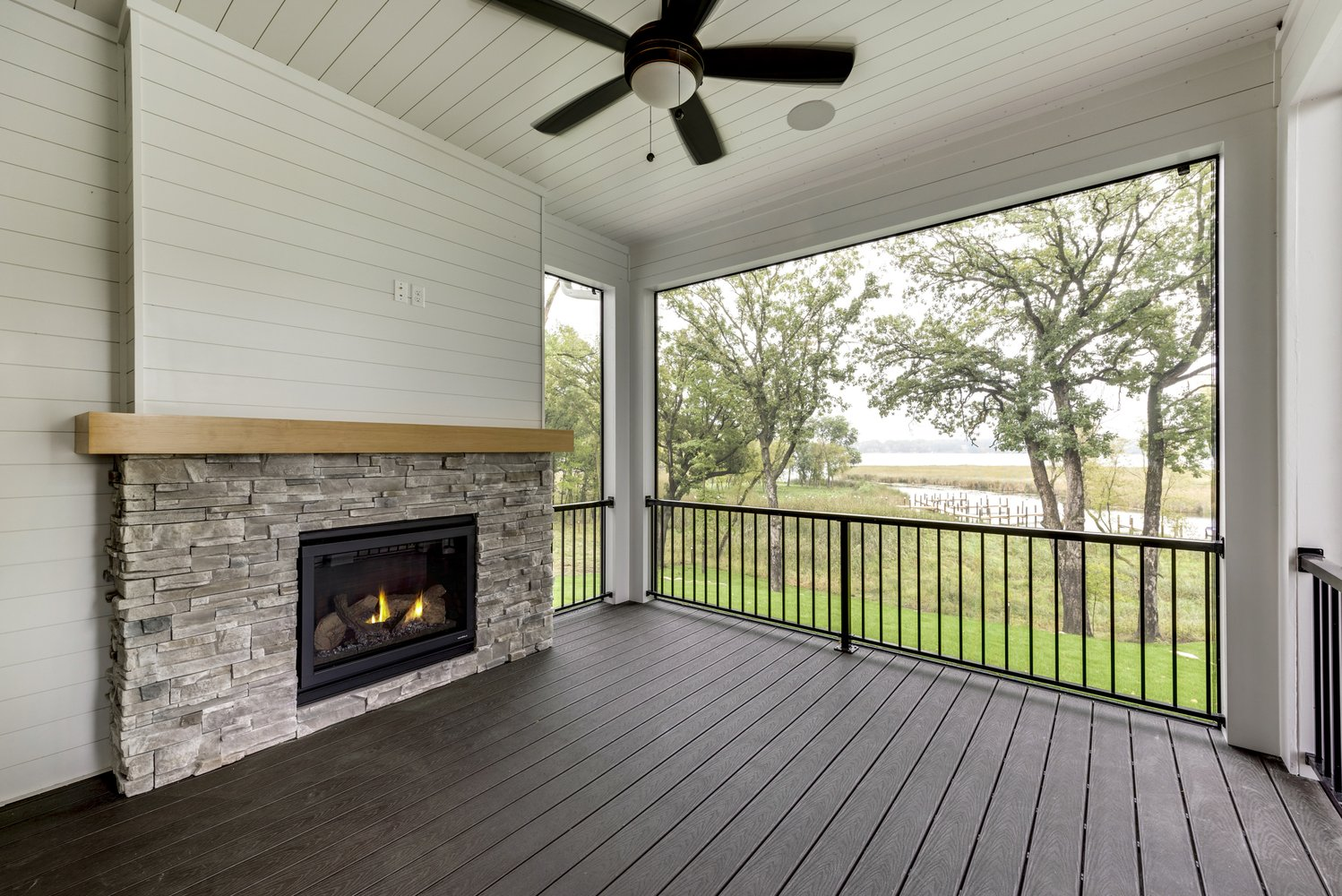 Fireplace on Porch with View of Lake Minnetonka