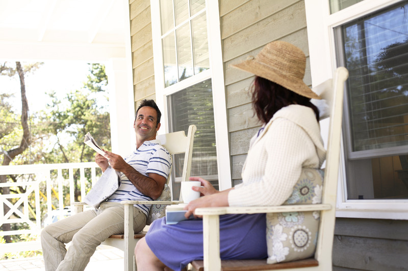 Couple on porch of lakeshore home